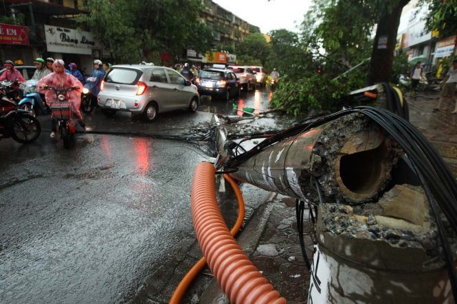 Historic storm batters Hanoi, killing two and felling trees