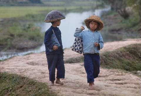 Children go to school barefoot wearing and straw hats