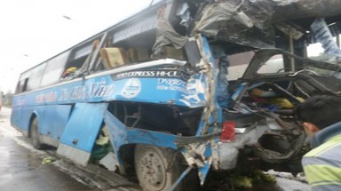 Two killed in coach-truck collision