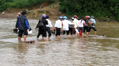 Crossing river to school, seven students swept away