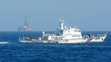 China moves oil rig, still in Vietnam's waters