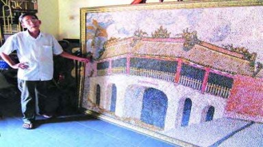 Shell paintings depict traditional town