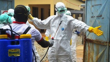 Guinea says Ebola spreads to regions near AngloGold mine