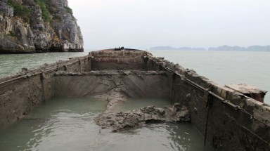 Police catch two ships secretly discharging mud into Ha Long Bay